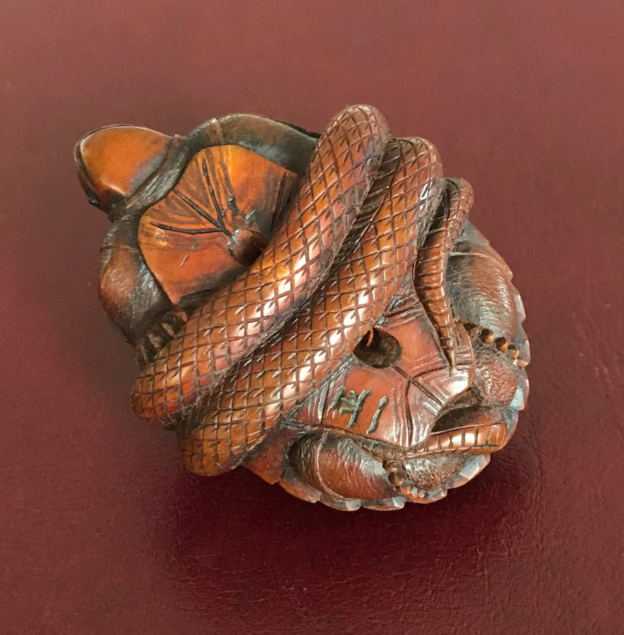 Netsuke of a snake wrapped around a tortoise